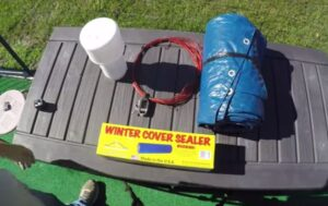 closing a pool for winter season with winterizing kit